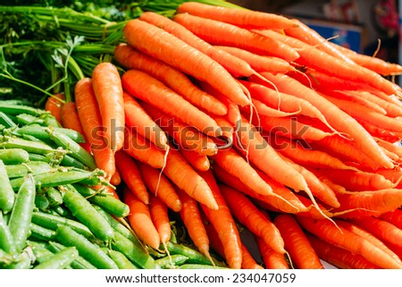 Fresh Vegetables Organic Green Beans And Orange Carrots. Production Of Local Food Market. - stock photo