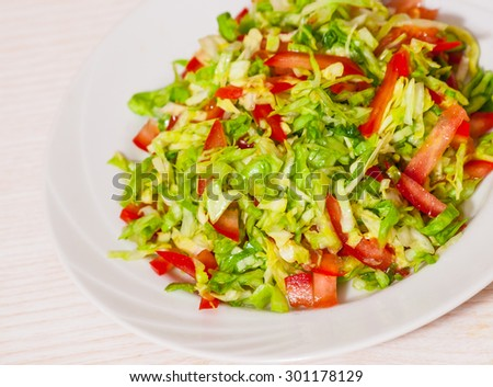 fresh vegetables salad with cabbage - stock photo