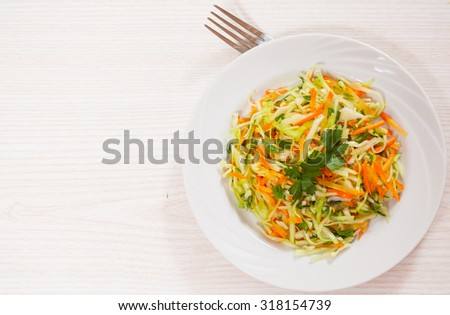 fresh vegetables salad with cabbage and carrot - stock photo