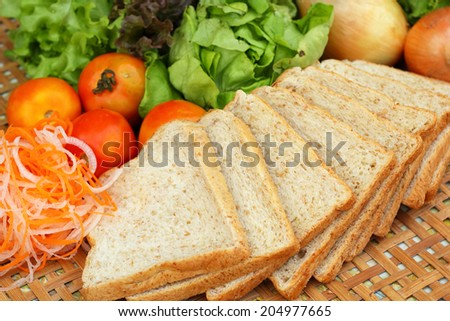 Fresh vegetables salad with whole wheat bread. - stock photo
