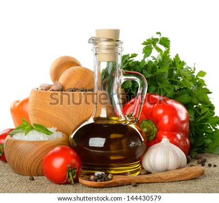 Fresh vegetables, spices and olive oil isolated on white background