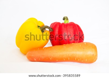 Fresh vegetables sweet Red, Yellow, Peppers and Kat carrot isolated on white background. - stock photo