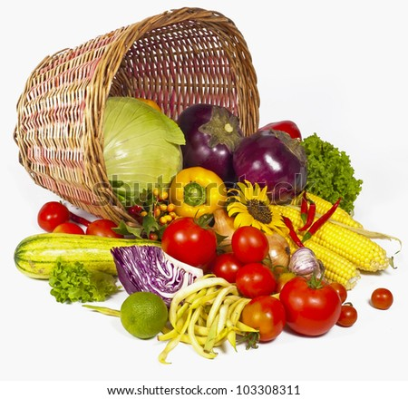 fresh vegetables with green leaves in the basket isolated on white background - stock photo