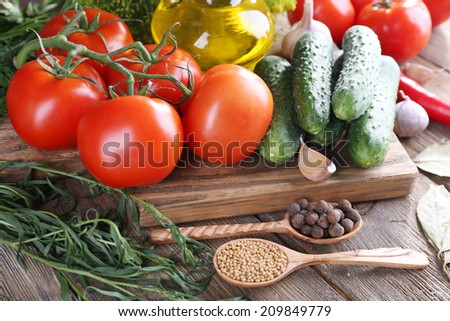 Fresh vegetables with herbs and spices on table, close-up - stock photo