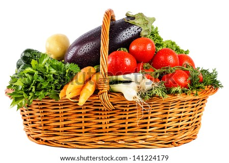 Fresh vegetables with water drops in basket isolated on white background - stock photo