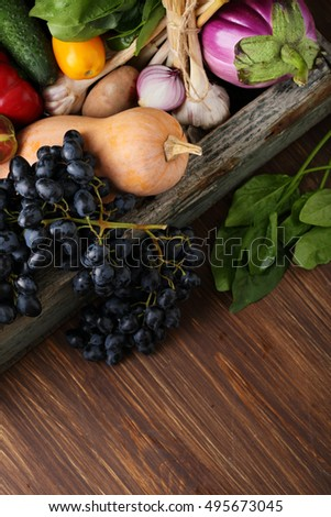 Fresh vegetables wood background, food top view