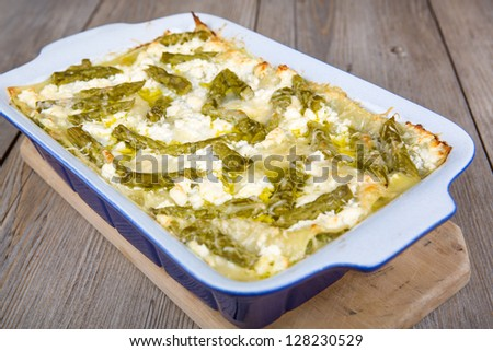 Fresh vegetarian lasagna with green asparagus - stock photo