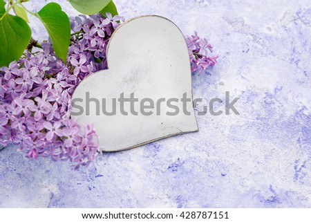 Fresh violet lilac flowers and heart  - stock photo