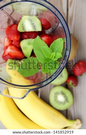 Fresh vivid smoothie ingredients and blender - stock photo