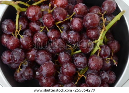 fresh washed organic red grapes - stock photo