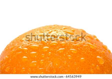 Fresh water drops on orange peel - stock photo