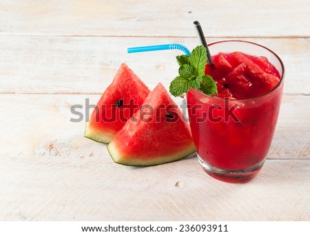 Fresh water melon drink on wood - stock photo