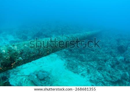 Fresh water pipe underwater. - stock photo
