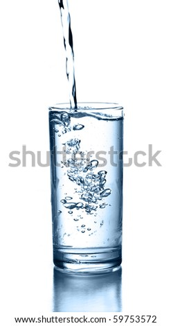 Fresh water pouring in a glass on white background. - stock photo