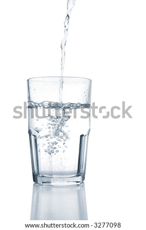 Fresh water pouring into a glass, isolated on white.