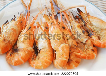 fresh water shrimp grilled on fire ready to eat on white dish - stock photo