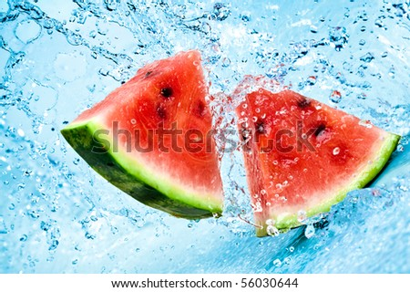 fresh water splash on red watermelon - stock photo