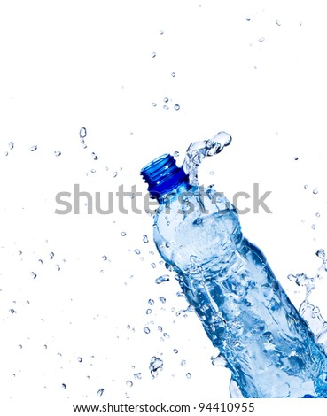 Fresh water splashing out of bottle, isolated on white background - stock photo