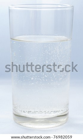 Fresh water, vodka, whiskey, soda, gin in 1 glass - stock photo