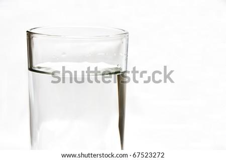 Fresh water, vodka, whiskey, soda, gin in 1 glass isolate on white background - stock photo