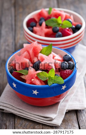 Fresh watermelon cut in star shape with blueberries - stock photo