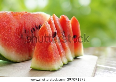 fresh watermelon fruit sliced on green nature bokeh background