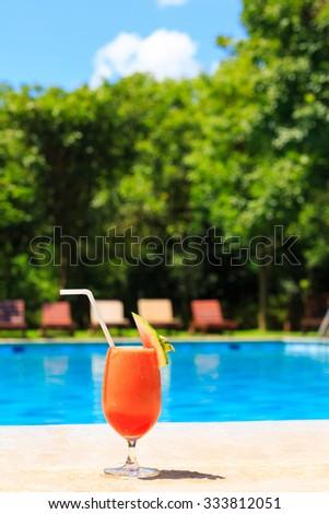 Fresh watermelon juice cocktail near the swimming pool - stock photo