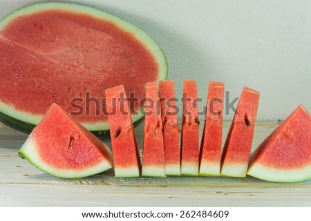 fresh watermelon sliced on wooden table. selective focus on fresh watermelon - stock photo
