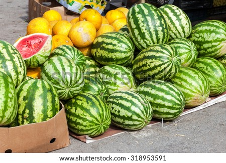 Fresh watermelons for sale at the local farmers market - stock photo