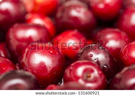 Fresh Wet Cherries Displayed In A Fruit Market - stock photo