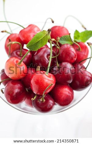 Fresh wet cherry in a glass, close up