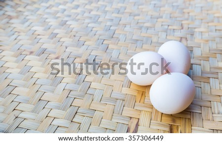 fresh white eggs on weave wood backgrounds