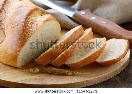 fresh white loaf of bread , rustic style