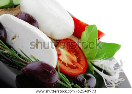 fresh white mozzarella cheese with vegetables on black - stock photo