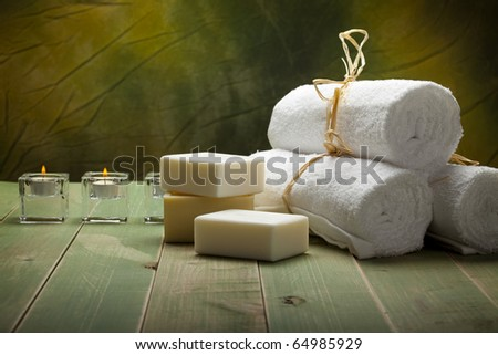 Fresh white towels, soap and candle - stock photo