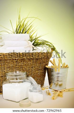 Fresh white towels with soap and clothespins for the laundry day - stock photo