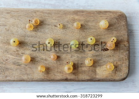 Fresh white whine grapes on a chopping board