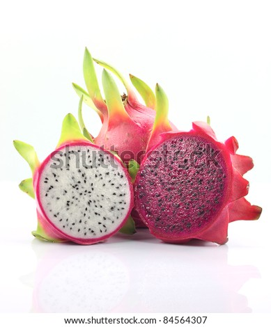 Fresh whole and two half dragon fruit isolated white background. Dragon fruit or Pitaya is the plant in Cactaceae family or Cactus. - stock photo
