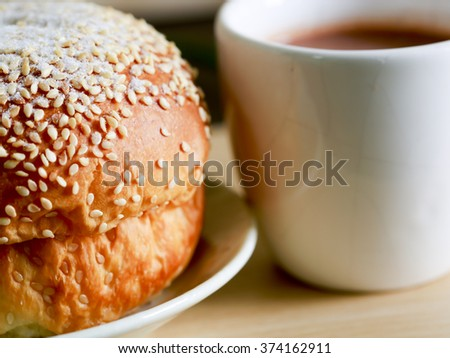 Fresh whole grain bread and a cup of coffe - stock photo