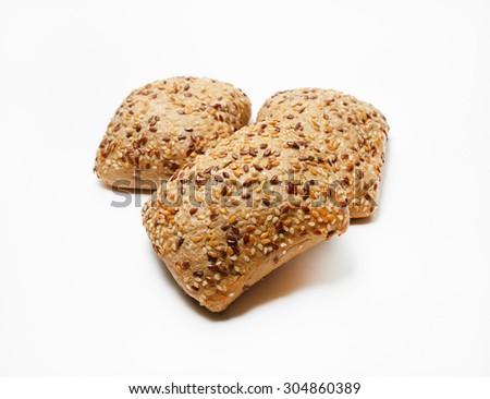 Fresh whole grain bread with sesame. Selective focus. - stock photo
