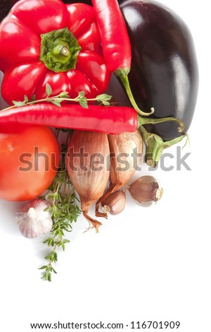 Fresh whole onion, bellpepper and brinjal waiting to be used as ingredients in vegetarian cooking - stock photo