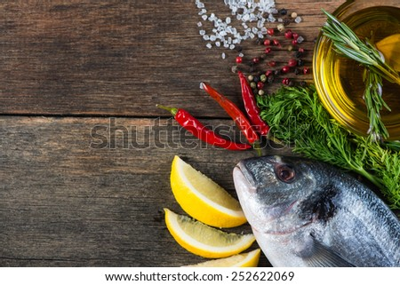 Fresh whole sea fish with aromatic herbs and spices - stock photo
