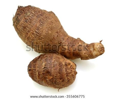 Fresh whole taro root over white background - stock photo