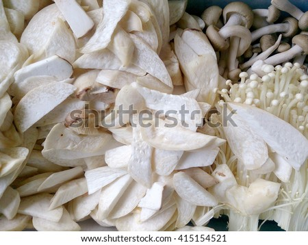 Fresh whole white button mushrooms, or agaricus,ready to be cleaned and washed for dinner, overhead view, top view - stock photo