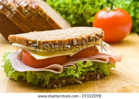 Fresh wholemeal cheese and ham sandwich - stock photo