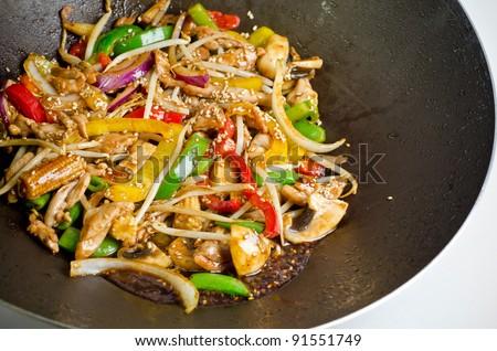 Fresh wok meal in a wok pan - stock photo
