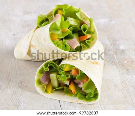 Fresh wrap sandwiches filled with ham, lettuce and pepper