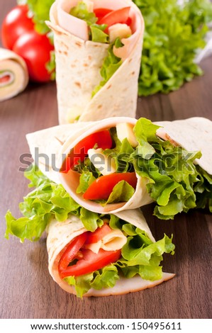 Fresh wrap snadwich with turkey meat and fresh vegetables - stock photo