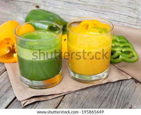Fresh yellow and green paprika smoothie juice - stock photo