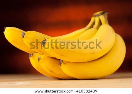 Fresh, yellow and sweet bananas on the table - stock photo
